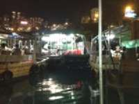 Shun Kee Typhoon Shelter <p> 	Dinner is being prepared on the kitchen boat in the middle.  It is servicing the boats tied to it.</p>