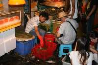 Huangsha Live Seafood Market <p> 	Vendors in the live market sell directly to the public and restaurants.</p>