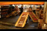Tsukiji Market <p> 	The buyers purchase the tuna, and haul it off using these wooden carts.</p>